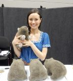 Summer Glau poses with stuffed wombats