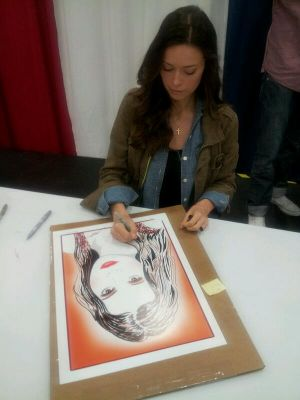 Summer Glau signing a print for 'The Women of Sci-Fi' at Dallas Comic Con, May 16 - 18, 2014