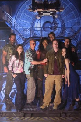 Joss Whedon strikes a pose with the Serenity crew