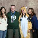 Summer Glau and Charisma Carpenter posing with a giraffe cosplayer