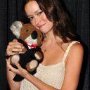 Summer Glau holds a stuffed animal koala