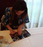 Meeting Summer back in 2009, she signed my Firefly DVD cover and we gave her a original Dutch Stroopwafel, which she posed with for us.