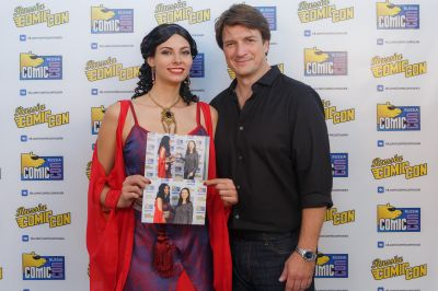 Nathan Fillion with cosplayer Blue Wolf dressed up as Inara from Firefly