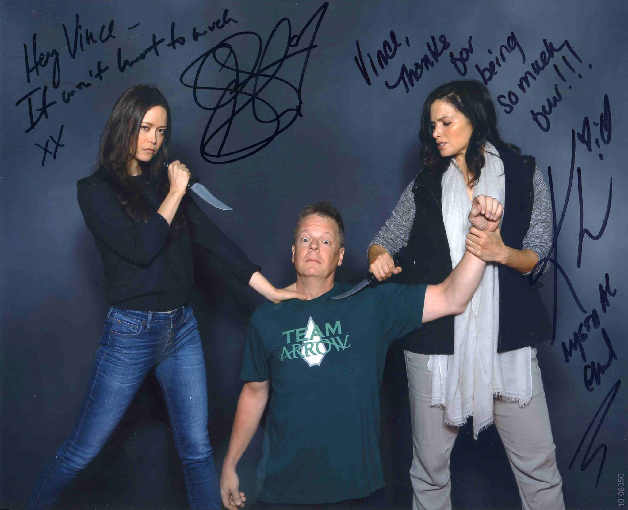 Got this photo with two of the bad girls from Arrow attacking me for being Team Arrow .