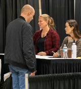 Celebrities interacting with fans at their booth during Tulsa Pop Culture Expo